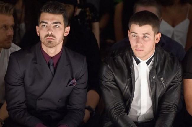 Joe Jonas and Nick Jonas at New York Fashion Week 2014