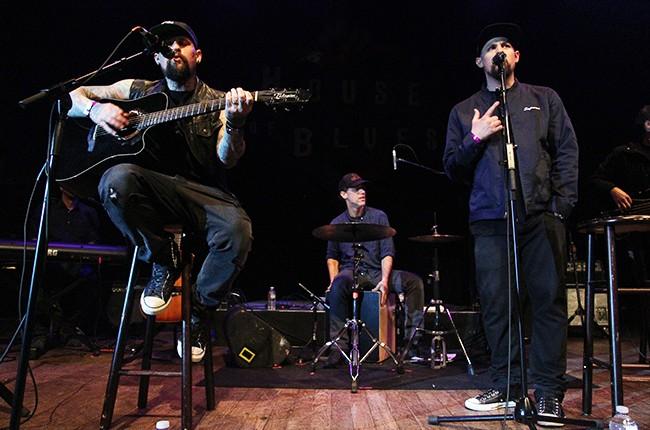Joel Madden and Benji Madden of Good Charlotte perform at The Imagine Ball 2015