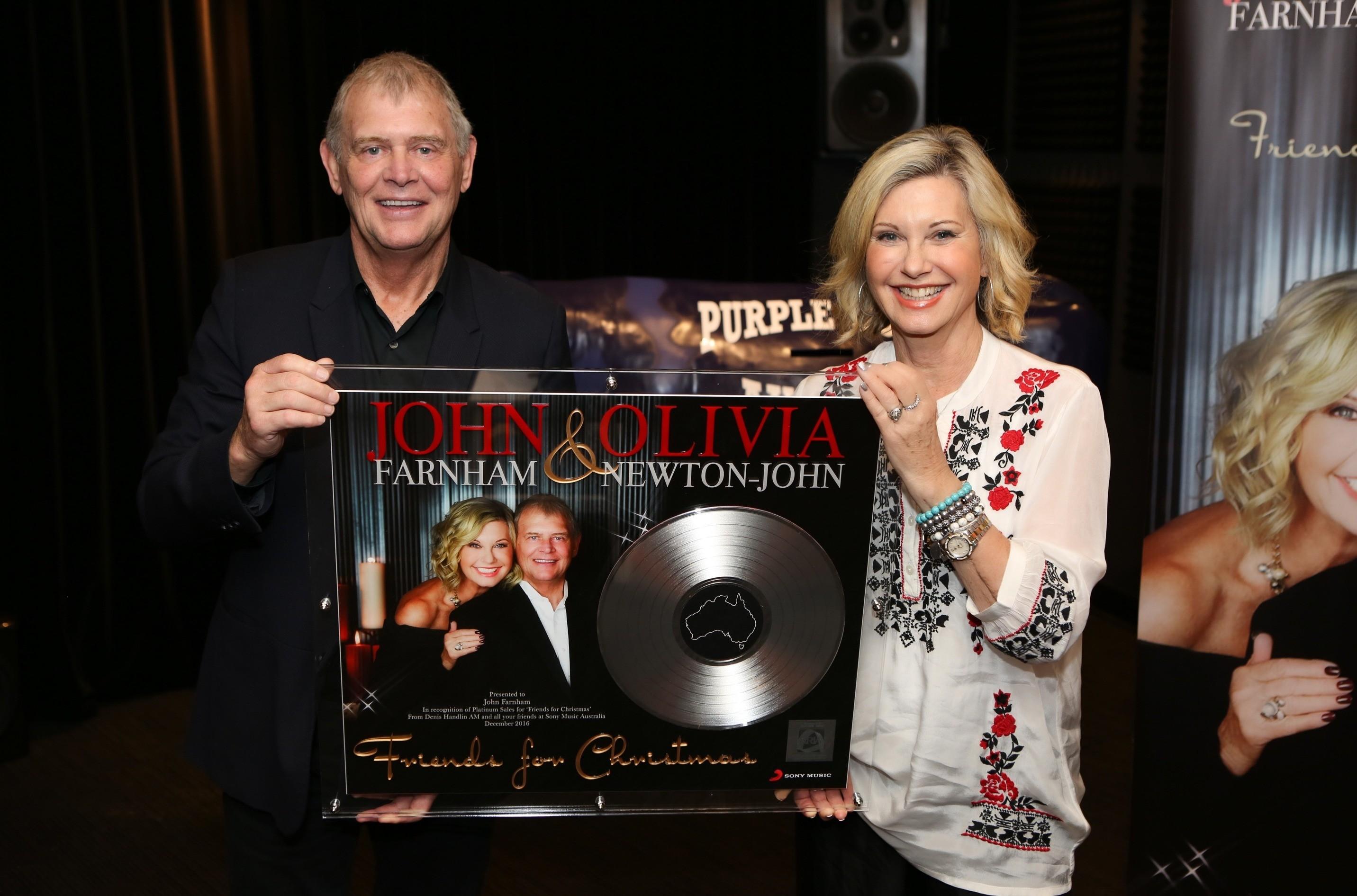 "John Farnham & Olivia Newton-John receive a plaque to commemorate platinum sales of ""Friends For Christmas"""