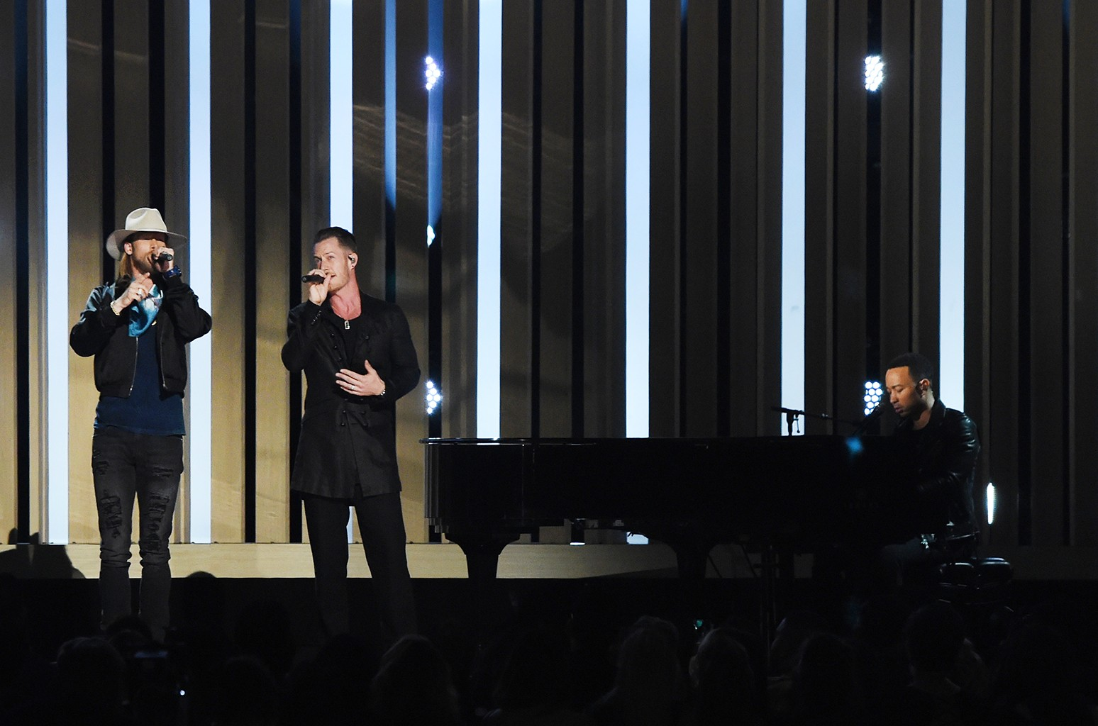 (L-R) Brian Kelley and Tyler Hubbard of Florida Georgia Line with John Legend perform onstage during the 2017 Billboard Music Awards at T-Mobile Arena on May 21, 2017 in Las Vegas.