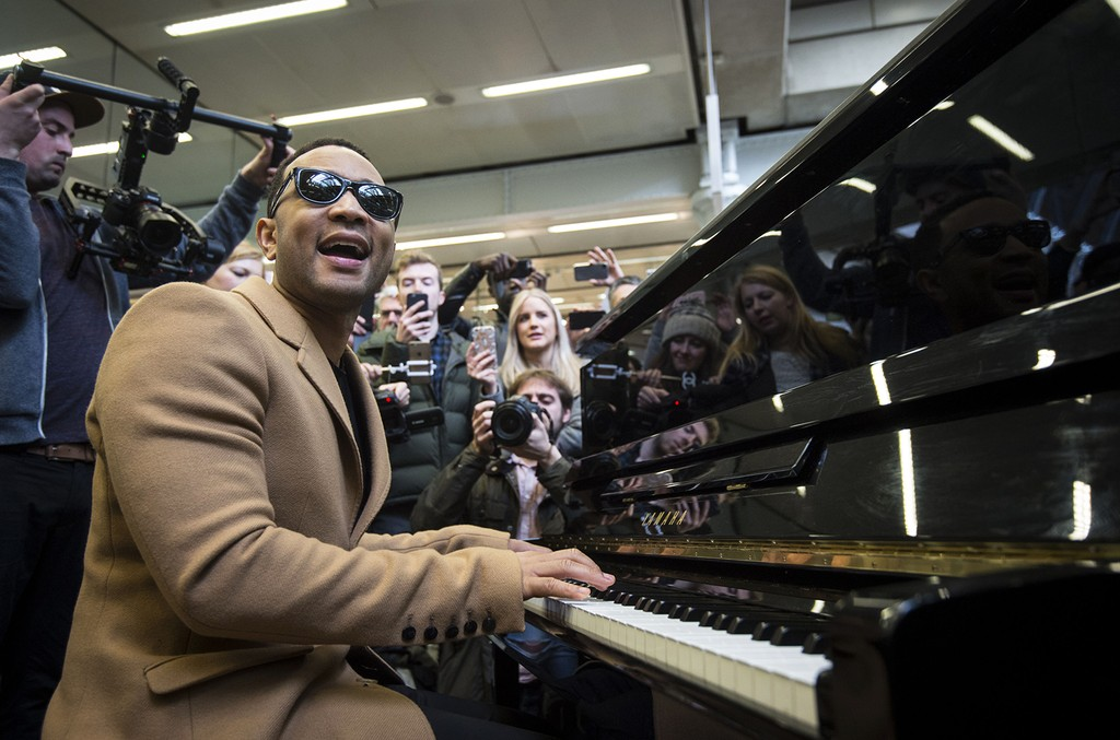 John Legend plays the Elton John piano at St Pancras Station, London.