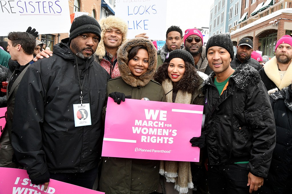 Jurnee Smollett-Bell and John Legend posed at Women's March on Main Street Park City on January 21, 2017 in Park City, Utah.  (Photo by George Pimentel/Getty Images)