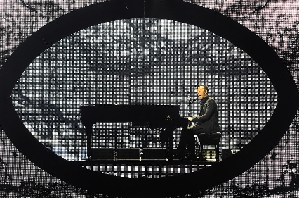 """John Legend performs during his """"Darkness and Light"""" tour in Los Angeles on May 28, 2017."""