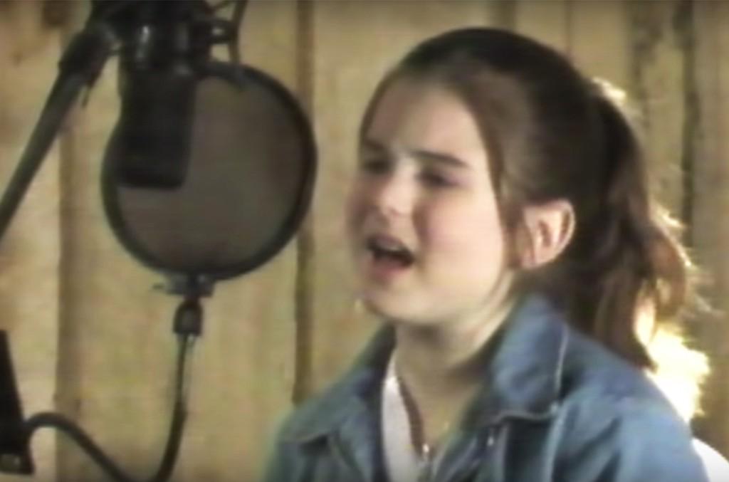 "JoJo in the video for ""Music."""
