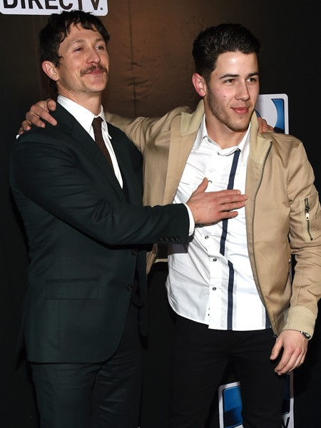 jonathan-tucker-nick-jonas-directv-super-bowl-parties-2015-billboard-450