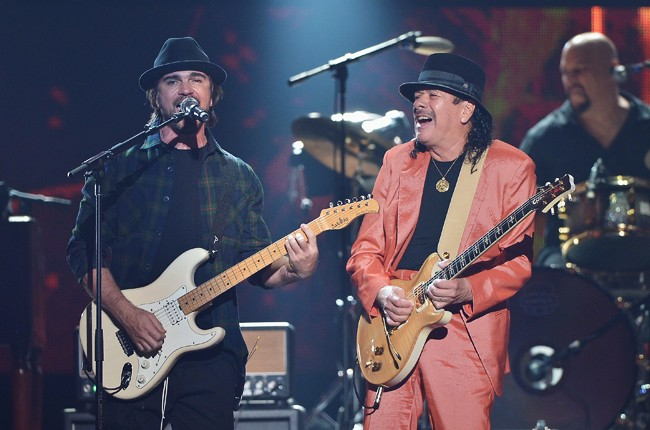 Juanes and Carlos Santana performs onstage at the 2015 Billboard Latin Music Awards