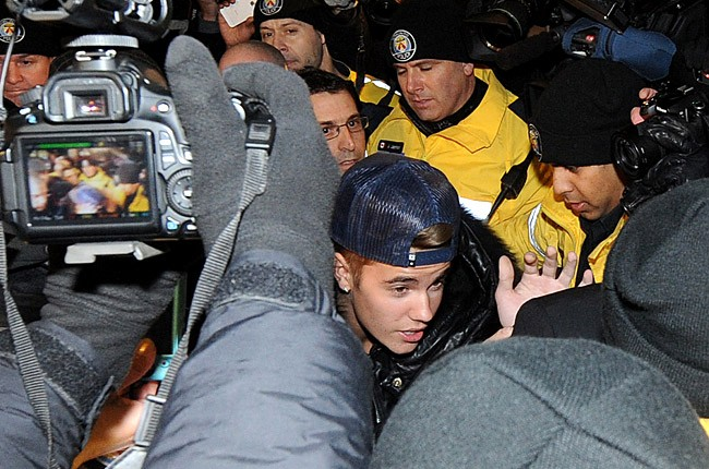 Justin Bieber appears at a police station in connection with an alleged criminal assault on January 29, 2014 in Toronto, Canada. (Photo by Jag Gundu/Getty Images)