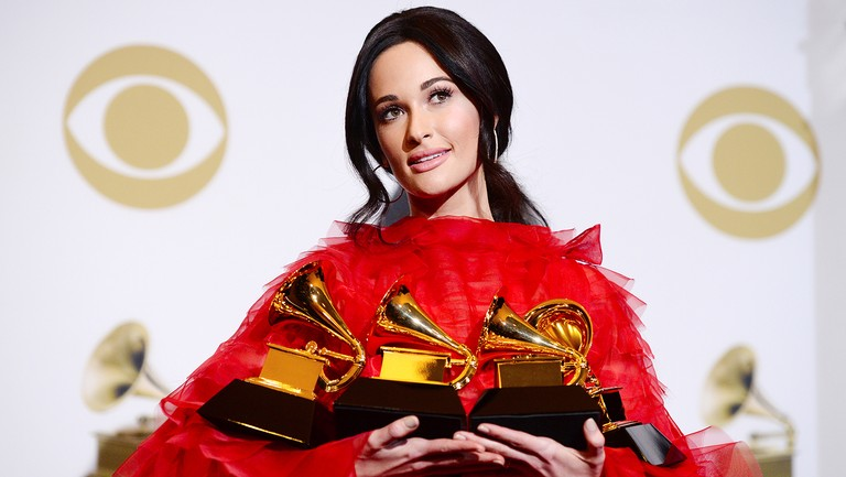 <p>Kacey Musgraves, winner of Album of the Year, Best Country Album, Best Country Song, and Best Country Solo Performance, poses in the press room during the 61st Annual Grammy Awards at Staples Center on Feb. 10, 2019 in Los Angeles.&nbsp&#x3B;</p>