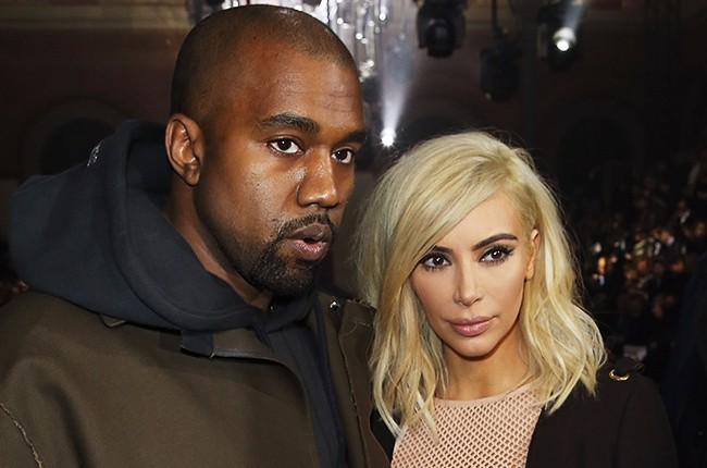 Kanye West and blonde Kim Kardashian attend the Lanvin