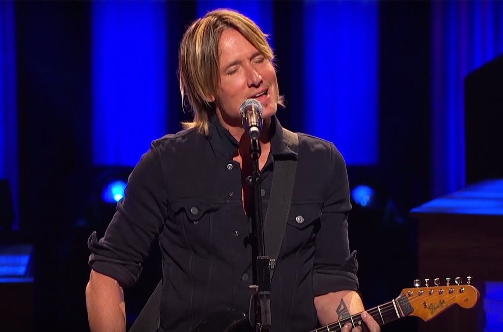 "Keith Urban performs ""The Fighter"" at the Grand Ole Opry in Nashville, Tenn."