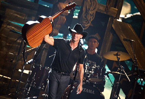 Kenny Chesney performs onstage at the 49th annual CMA Awards