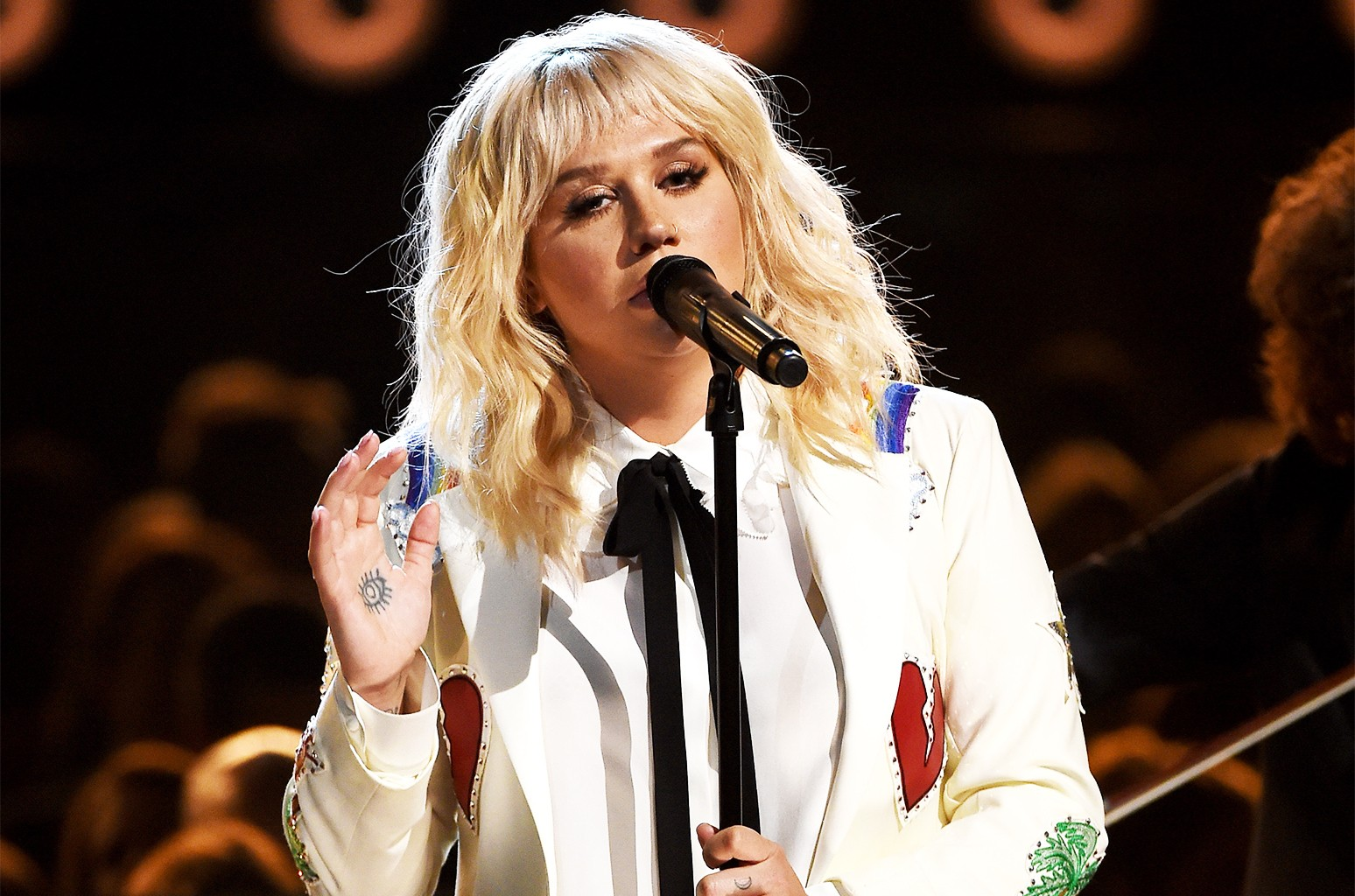 Kesha performs onstage during the 2016 Billboard Music Awards