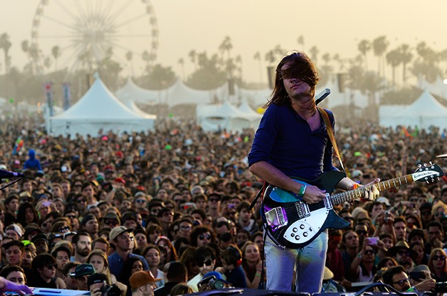 Kevin Parker of Tame Impala performs onstage during day 3 of the 2013 Coachella
