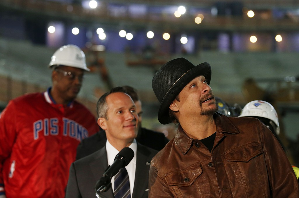 Kid Rock, right, stands with Christopher Ilitch, president and chief executive officer for Ilitch Holdings Inc., during a press conference at the Little Caesars Arena in Detroit on Jan. 19, 2017.