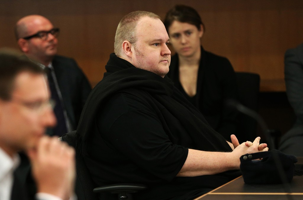 Internet mogul Kim Dotcom sits in court to hear the judges decision for the extradition case in Auckland on Dec. 23, 2015.