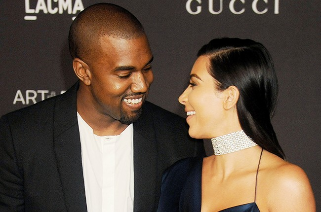 Kim Kardashian and Kanye West attend the 2014 LACMA