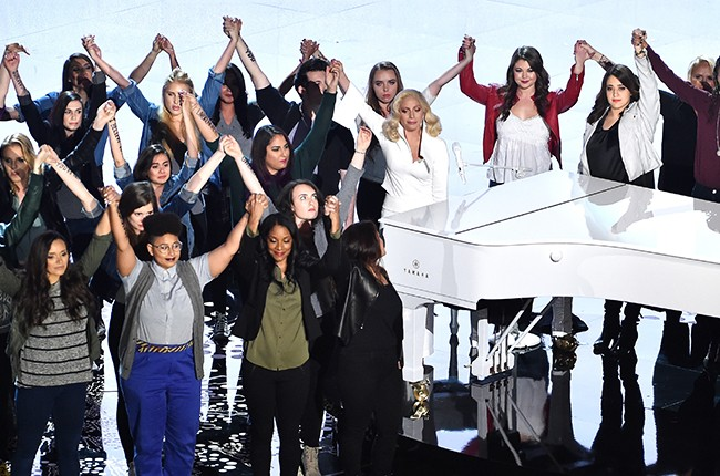 Lady Gaga onstage for her 2016 Oscars performance with sexual abuse survivors on Feb. 28 in Hollywood.