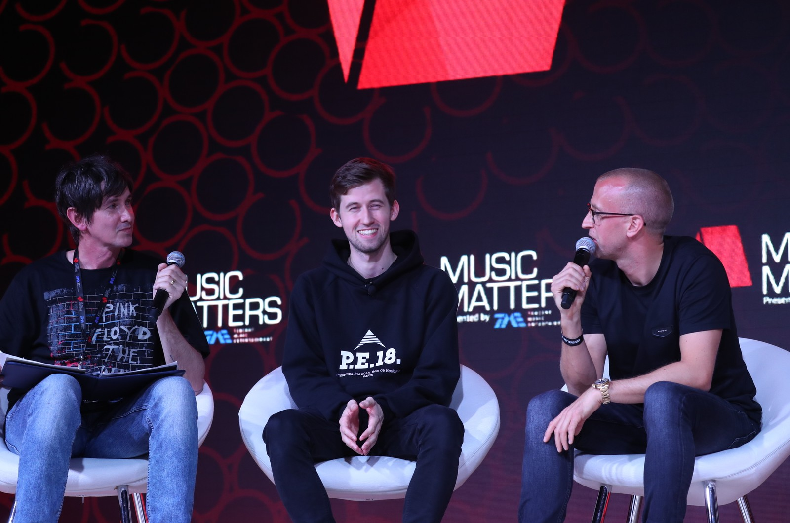 Billboard's Lars Brandle, DJ and producer Alan Walker and Liquid State managing director Gunnar Greve share a joke on stage at Music Matters 2018