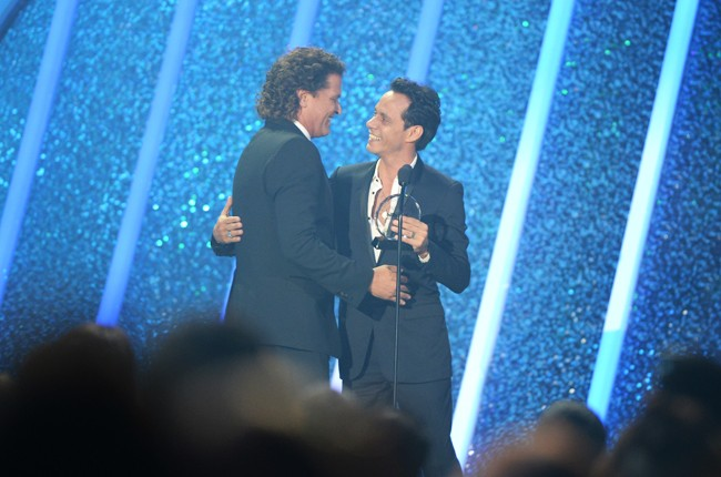 Carlos Vives and Marc Anthony onstage during the 2014 Billboard Latin Music Awards
