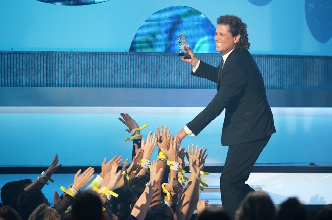 Carlos Vives performs onstage during the 2014 Billboard Latin Music Awards