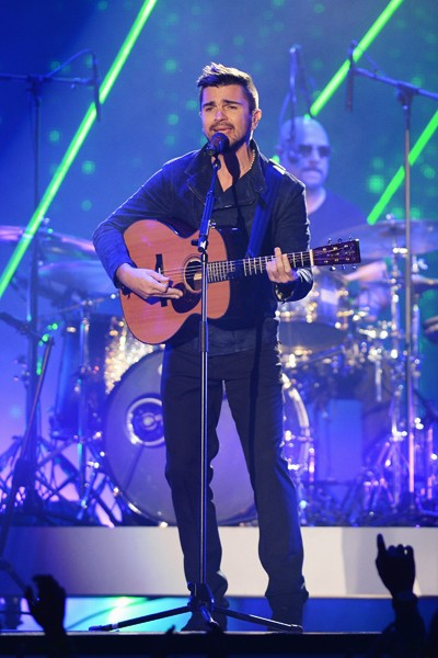 Juanes performs onstage during the 2014 Billboard Latin Music Awards