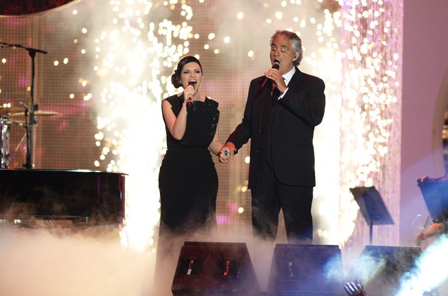 Laura Pausini and Andrea Bocelli perform onstage during the 2014 Billboard Latin Music Awards
