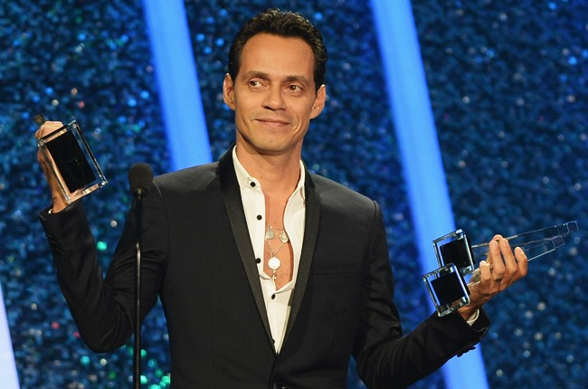 Marc Anthony accepts an award onstage during the 2014 Billboard Latin Music Awards