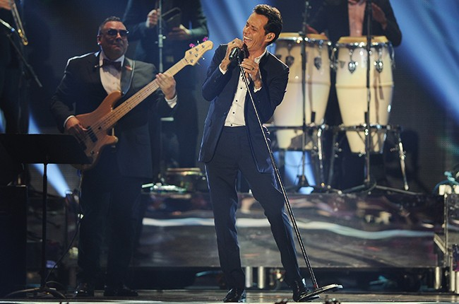 Marc Anthony performs onstage during the 2014 Billboard Latin Music Awards