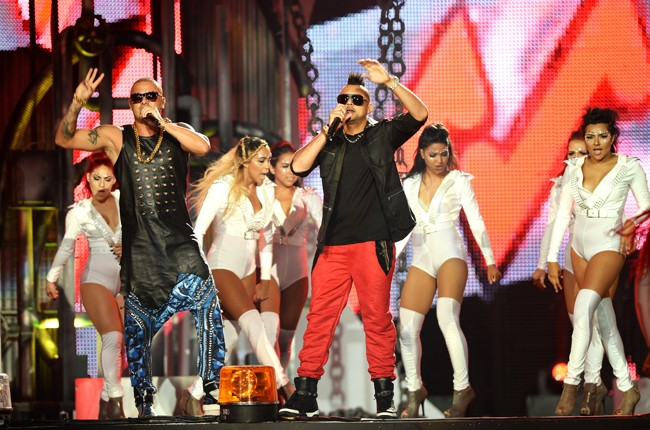 Wisin and Sean Paul perform onstage during the 2014 Billboard Latin Music Awards