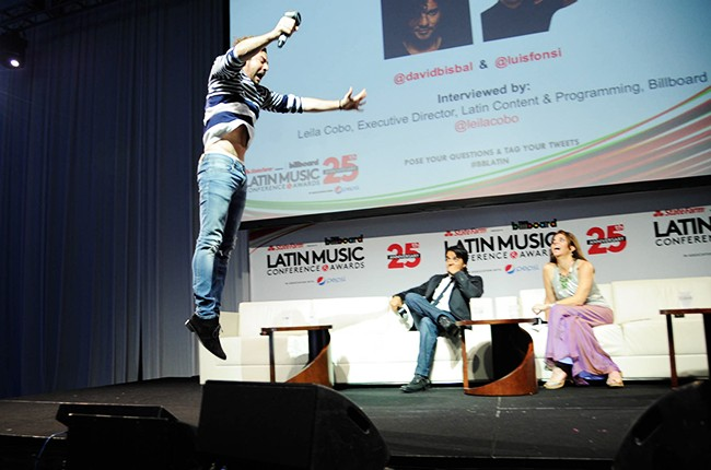 David Bisbal jumping on stage at the Billboard 2014 Latin Music Conference