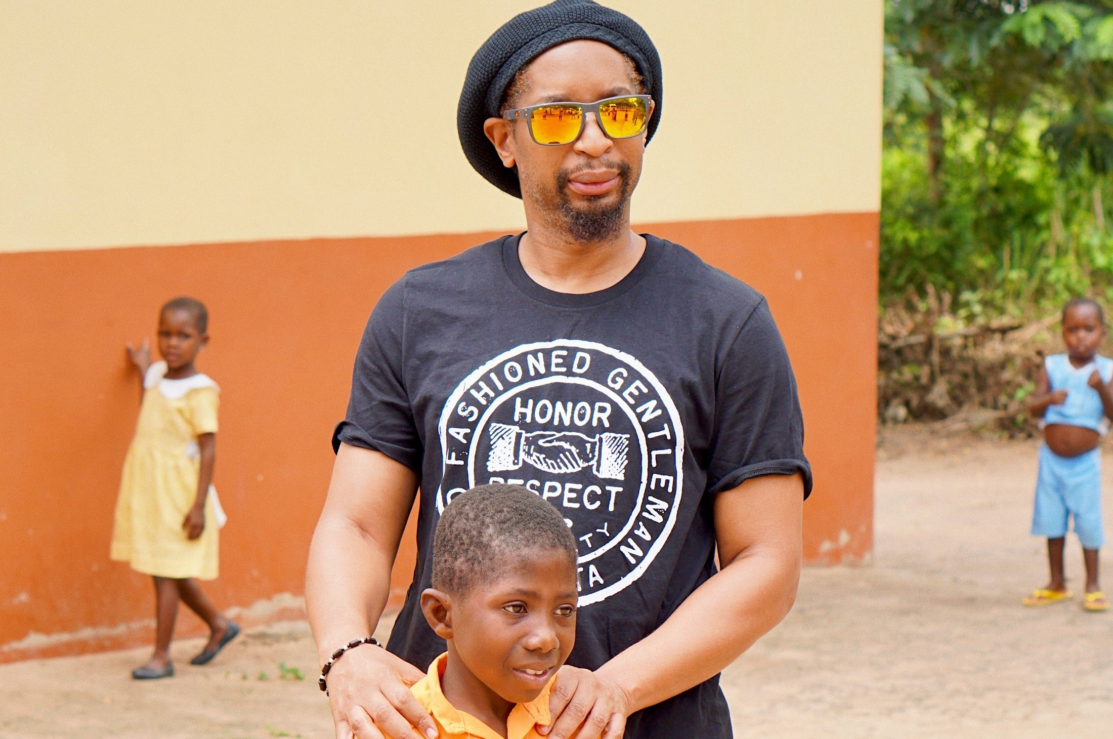 Lil Jon in the field with Pencils of Promise during the build of his schools in Ghana.
