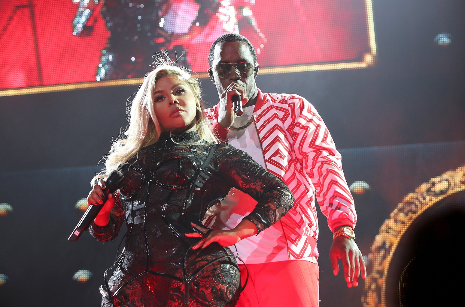 Lil' Kim and Puff Daddy perform during the Bad Boy Family Reunion Tour