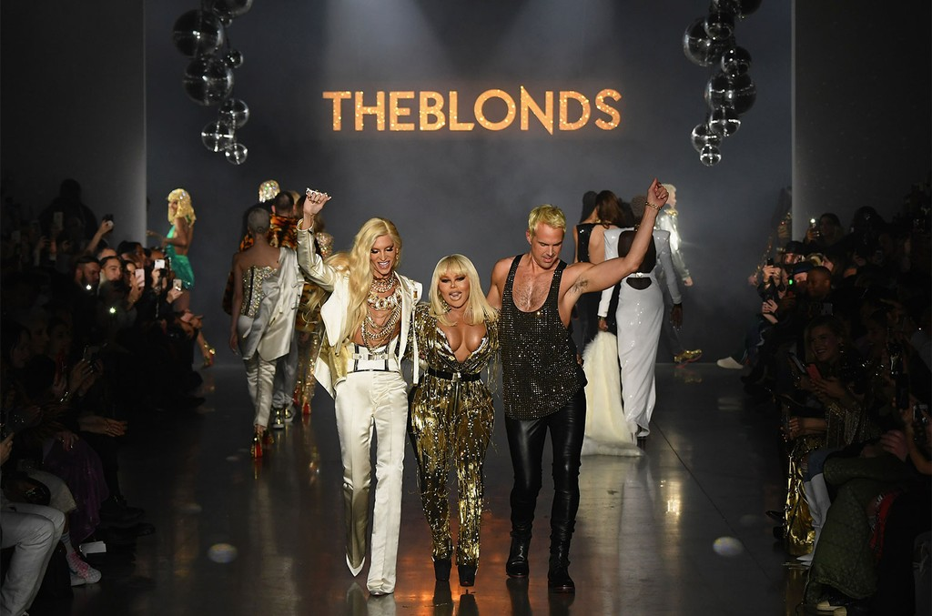 Phillipe Blond, Lil' Kim, and David Blond walk the runway for The Blonds