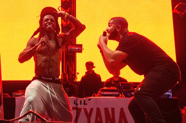 Lil Wayne and Drake perform during Lil Weezyana Festival at Champions Square on August 28, 2015 in New Orleans, Louisiana.