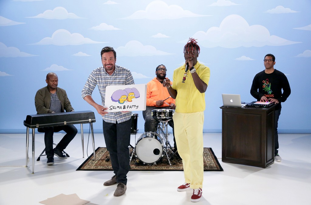 """(l-r) Host Jimmy Fallon and Lil Yachty with James Poyser, Ahmir """"Questlove"""" Thompson and Stro Elliot of The Roots during """"Simpsons Rap"""" on June 15, 2017."""