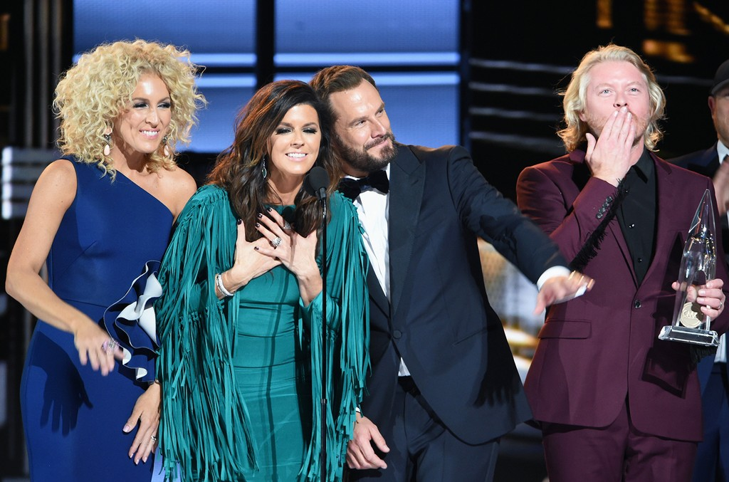 Little Big Town accept an award onstage at the 50th annual CMA Awards