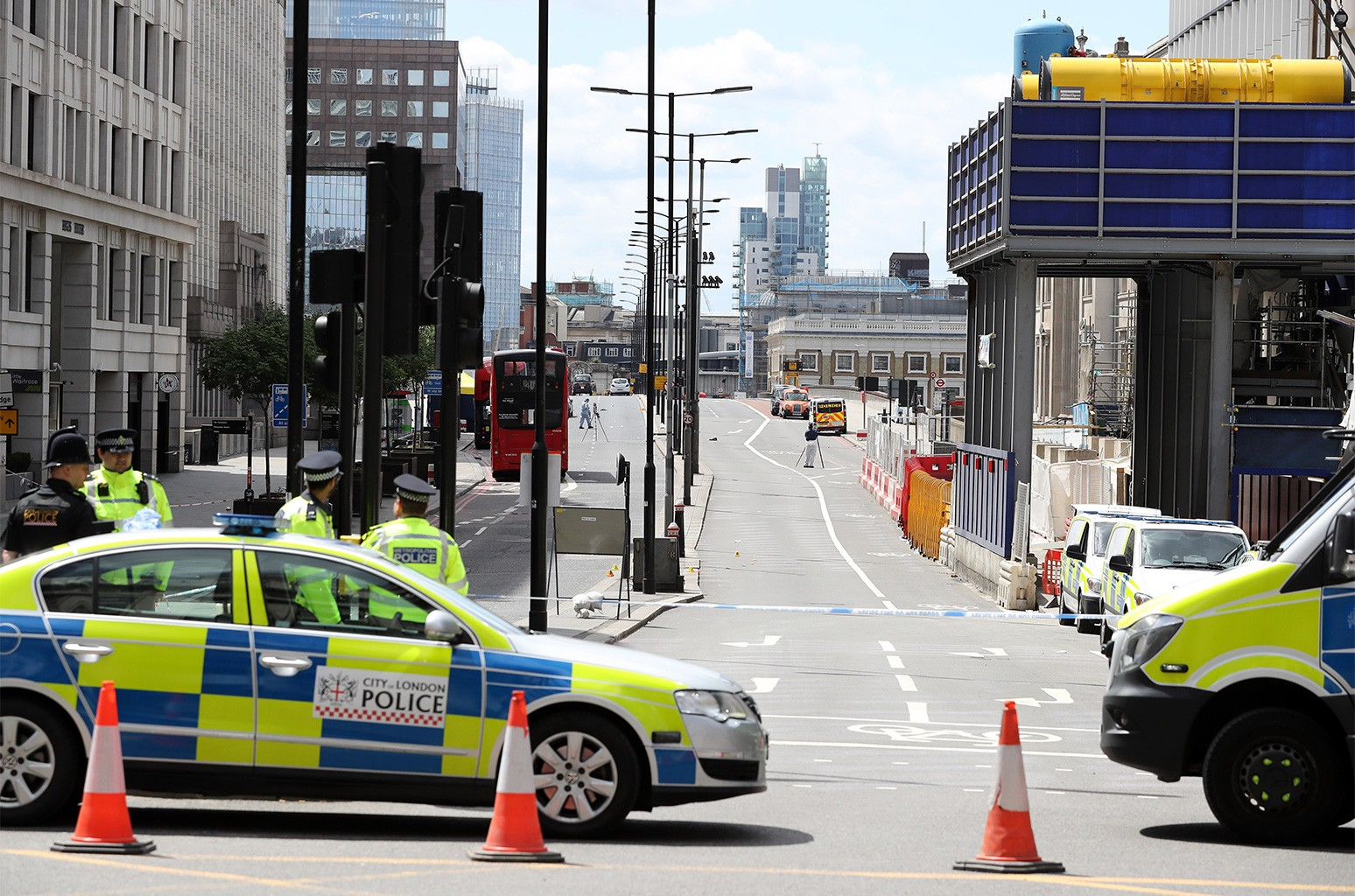 Police operate a cordon on the North side of London Bridge as forensic officers work after last night's terrorist attack on June 4, 2017 in London, England.