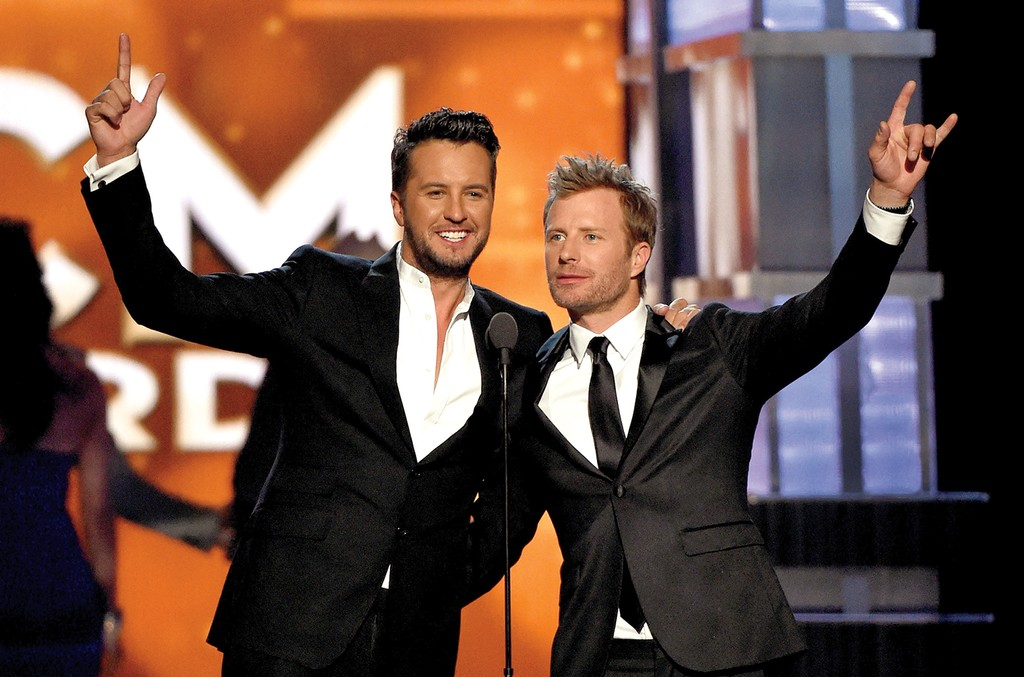 Luke Bryan (L) and Dierks Bentley speak onstage during the 51st Academy of Country Music Awards at MGM Grand Garden Arena on April 3, 2016 in Las Vegas.