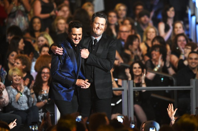 luke Bryan and Blake Shelton speak onstage during the 50th Academy Of Country Music Awards