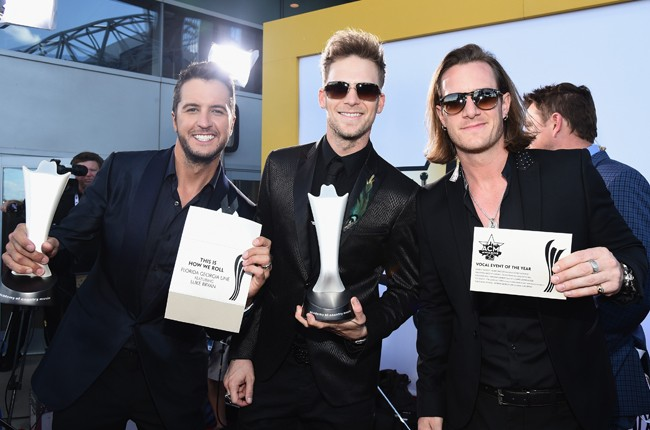Luke Bryan and Brian Kelley and Tyler Hubbard of music group Florida Georgia Line attend the 50th Academy Of Country Music Awards