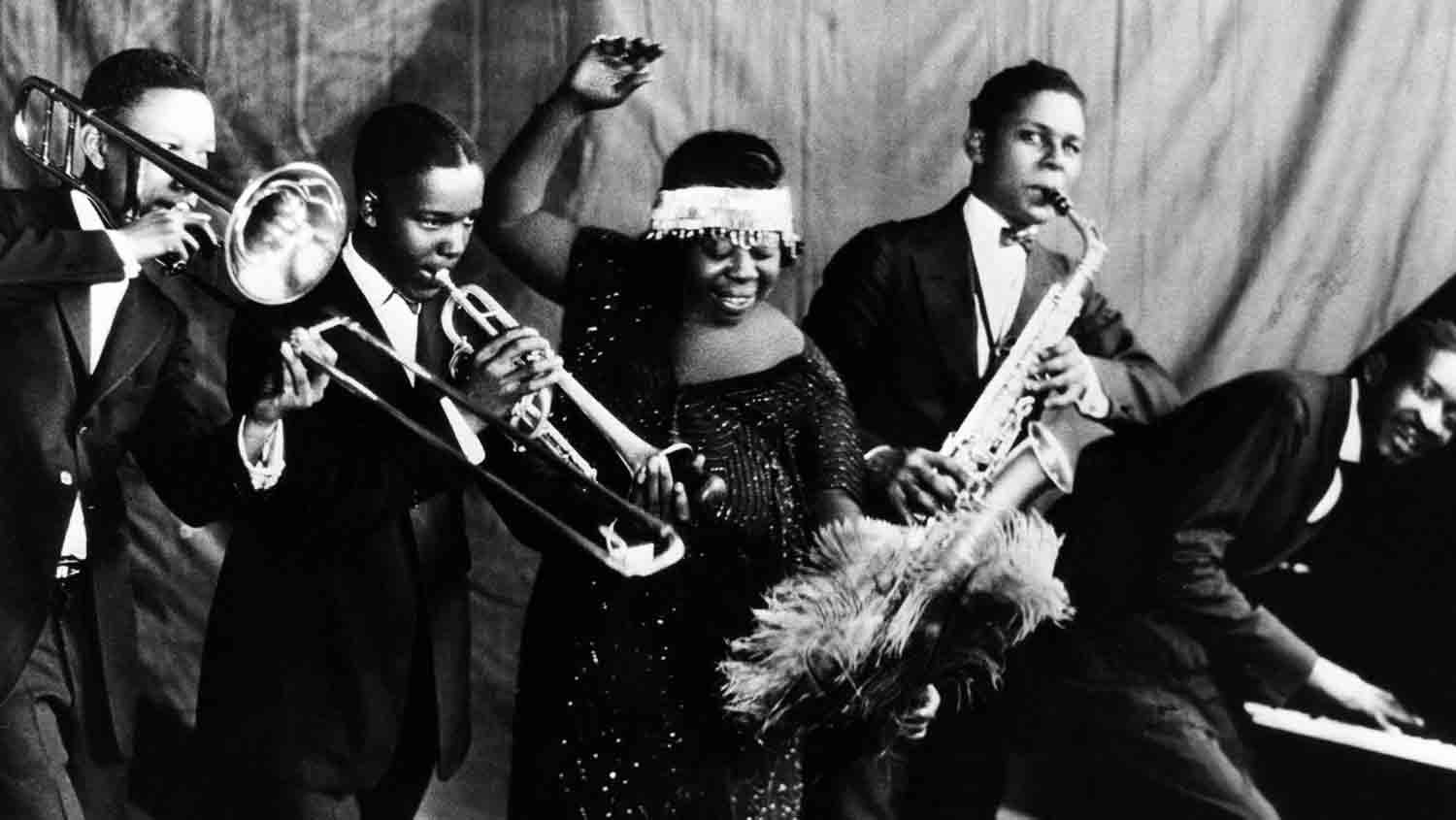 Ma Rainey Georgia Jazz Band pose for a studio group shot c 1924 with 'Gabriel', Albert Wynn, Dave Nelson, Ma Rainey, Ed Pollack and Thomas A Dorsey.