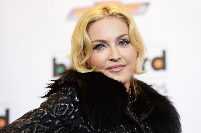 Madonna poses in the press room during the 2013 Billboard Music Awards