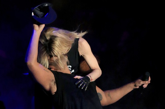 Madonna and Drake kiss onstage during day 3 of the 2015 Coachella