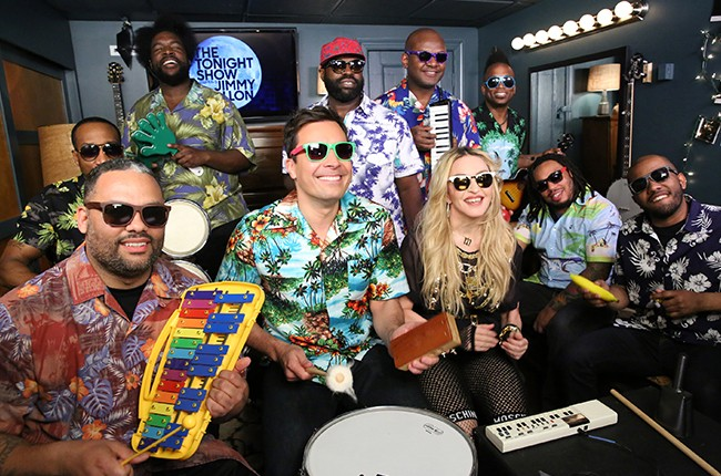 "Madonna, Jimmy Fallon and The Roots perform ""Holiday""  using childrens' toys on The Tonight Show Starring Jimmy Fallon on April 9, 2015."