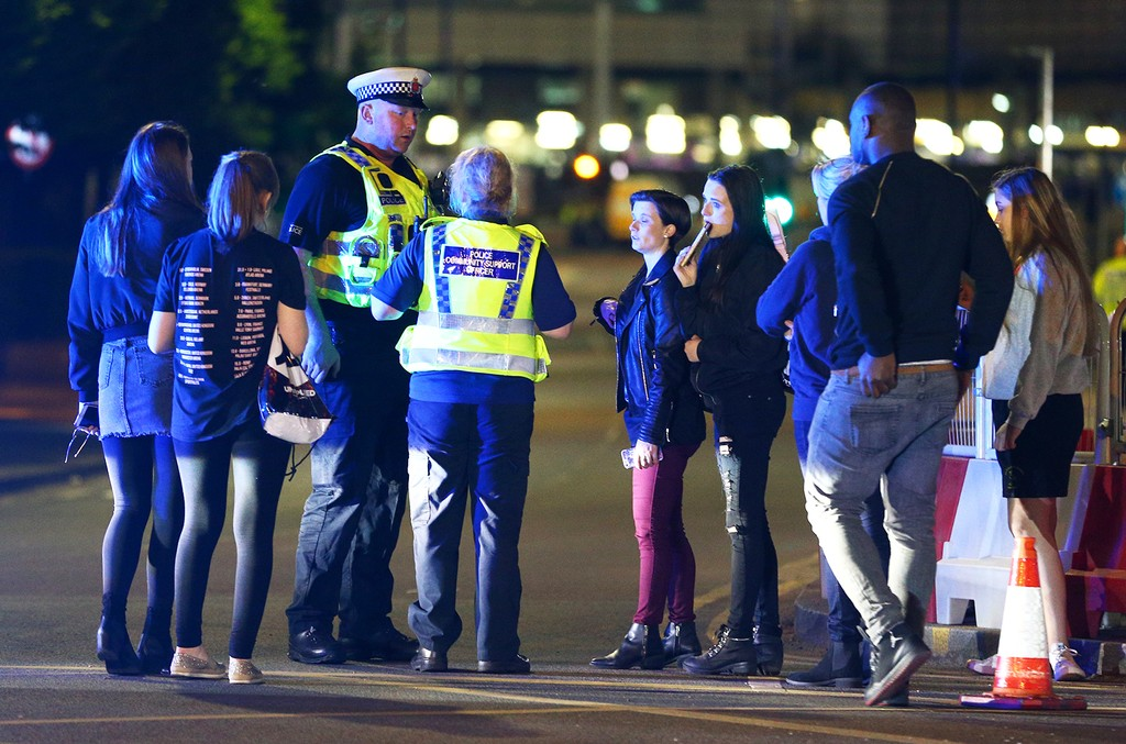 Police and fans close to the Manchester Arena on May 23, 2017 in Manchester, England.