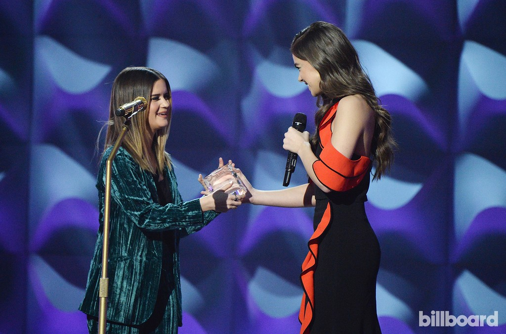 Maren Morris accepts an award from Hailee Steinfeld onstage during the Billboard Women in Music 2016 event on Dec. 9, 2016 in New York City.