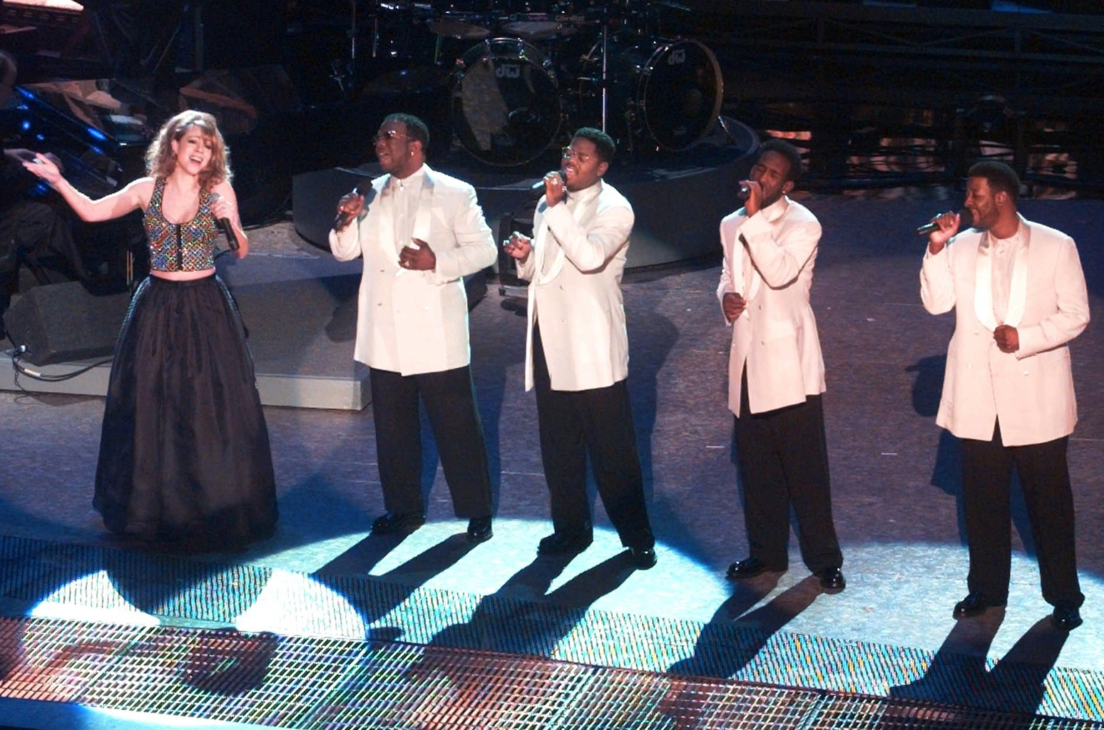 Mariah Carey performs with Boyz II Men during the opening of the 38th annual Grammy Awards at the Shrine Auditorium in Los Angeles on Feb. 28, 1996.