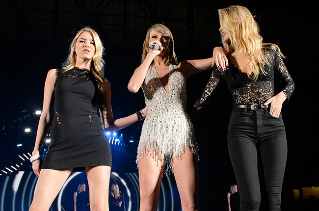 Martha Hunt,  Taylor Swift and Gigi Hadid perform on stage during the 1989 World Tour Live