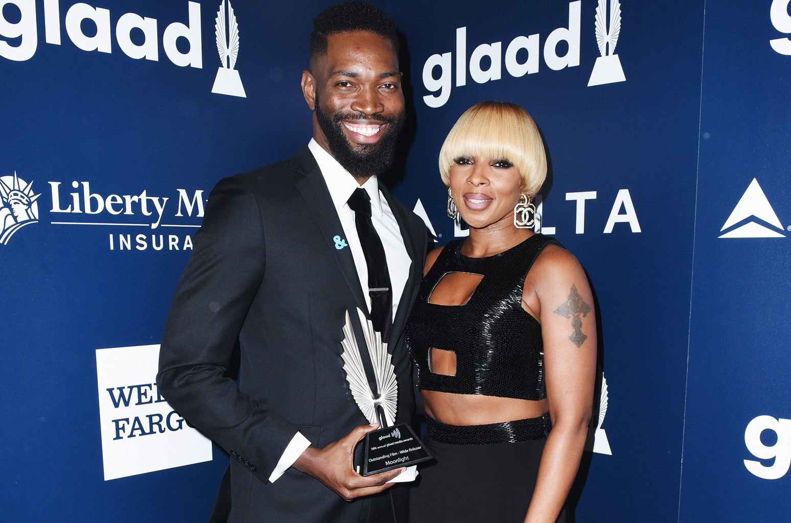 Screenwriter Tarell Alvin McCraney (L) and singer Mary J. Blige pose with the Outstanding Film - Wide Release award for 'Moonlight' during the 28th Annual GLAAD Media Awards in LA at The Beverly Hilton Hotel on April 1, 2017 in Beverly Hills, Calif.