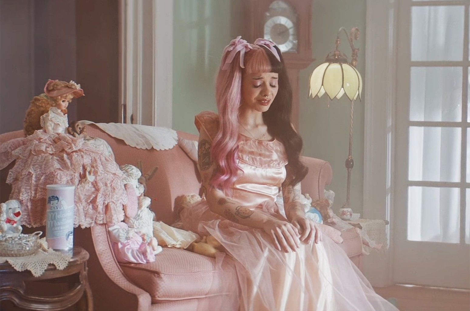 Melanie Martinez in a commercial for Cry Baby Perfume Milk.
